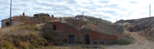 Traditional wine cellars are built into the hillside in Reliegios